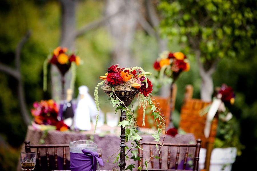 vibrant table arrangements with ivy. http://www.chrisdiset.com/main.php#/images/wedding-images/details