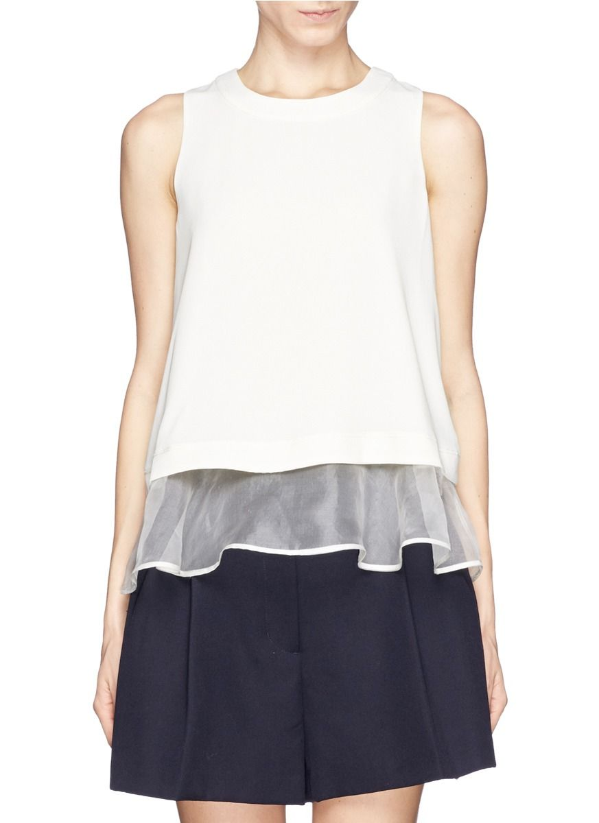Update your look with minimalist basics with this layered top from Elizabeth and James. Under laid with an exposed peplum in silk organza, this top will add effeminate undertones with a touch of girlish flair.