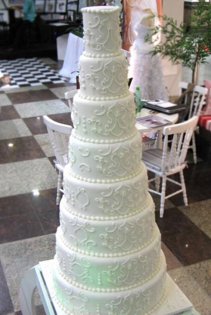 8 tier round white wedding cake with pearl beads. Don\'t need that ...