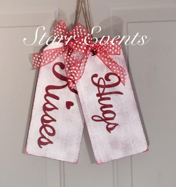Hugs and Kisses sign  Wooden tag signs  Valentine's Day Sign  Valentine's Day decorations Rustic signs  Valentine's Day door decor - Valentines sign, Valentine decorations, Valentines diy, Valentine day crafts, Valentine's day diy, Valentines day decorations - Hugs and kisses! Great Valentine's Day decoration or wedding decoration  Set of 2 tags  The come ready to hang with jute and a  bow! Bow color will vary depending on the ribbon availability   These signs measure 12  X 5 5  (sizes will vary slightly)   All items are made to order   We try to get your item out to you as quick as possible  All the wood I use comes from left over scrap wood from my husband's construction company  Therefore, some boards are smooth while others are a rougher cut  I do not guarantee the cut of wood you will be getting  All of my signs have a distressed look  To give it that distressed look, I sand them after I paint them  When this happens, some of the letter color will be speckled in the background of the sign  There will be imperfections, or markings and I make no attempt to remove them or cover them up as I believe it gives the items character! ) The letters are all painted and not vinyl  The paint is applied thick on some signs, so it may feel like vinyl, but it is not   I use all exterior paint and finish them off with a clear coat, so they can be used inside or out  Keep in mind that some colors will fade if left in direct sunlight for extended periods of time  Please note that no two will be exactly alike  Extra items in the picture not included  Even though I do sand the wood, splinters are still possible,, be careful! Since it is wood, bowing and warping are also possibilities   I encourage you to see my shop policies for an additional information  All of my items come from a smoke free environment
