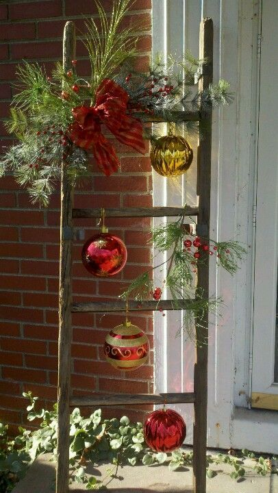 outdoor christmas decor using old ladder for front porch
