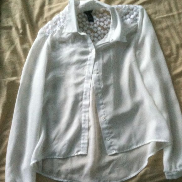White button down sheer top White button down sheer top. The flowered pattern on top on the back gives the shirt some character and makes it less boring. Cute by itself or open with a colored shirt underneath! Forever 21 Tops Button Down Shirts