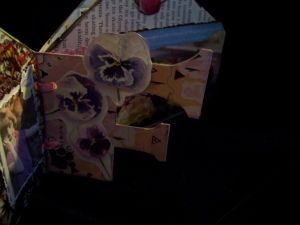 mini scrapbook using book pages as backgrounds