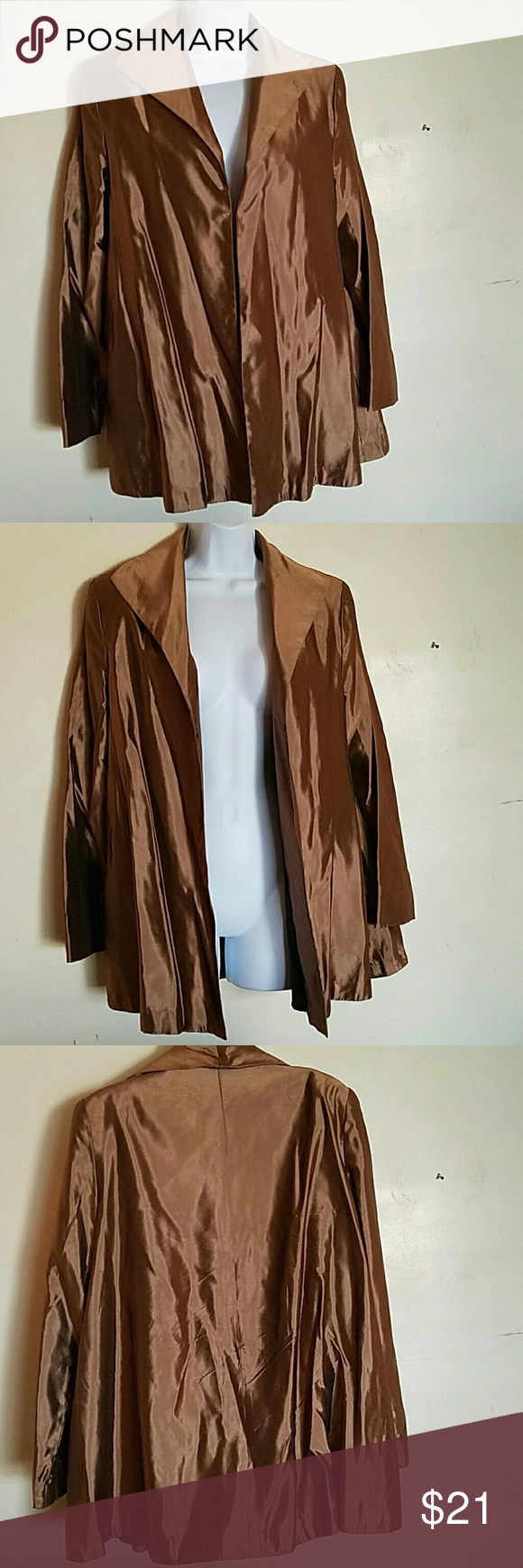 Silky Swing Jacket by Jessica McClintock Cape-like, silky jacket with 2 front snaps. Great for dress-up and special occasions. Good shape. Lightly worn. Dark champagne color. Jessica McClintock Jackets & Coats Capes