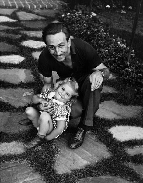 Walt and Lillian's daughter Diane was born December 18, 1933. Here, Disney plays with a young Diane in the front yard in 1936. Credit: Courtesy of the Walt Disney Archives Photo Library ©Disney