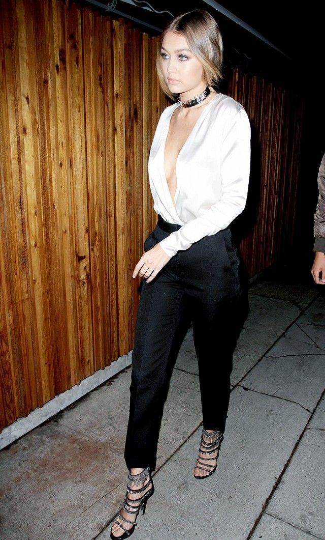 52e42e23e Gigi Hadid wears a white plunging-neckline top