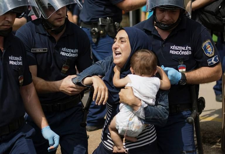 Sept. 3, 2015: Keleti train station, Budapest, desperate refugees being treated worse than animals.