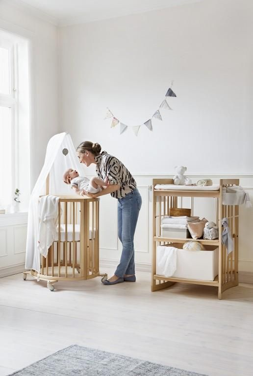 a stunning stokke nursery space stokke sleepi mini crib and stokke care changing table in. Black Bedroom Furniture Sets. Home Design Ideas