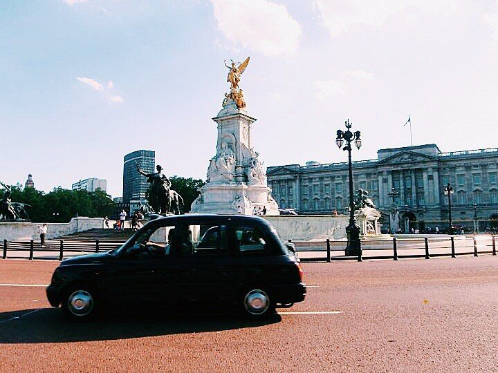 I don't think I could fit anymore iconic London images into a shot if I tried! The palace the Victoria monument and a black cab!! by hungrybellytravels