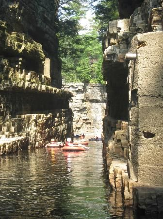 In upstate New York, there is a place called Ausable Chasm, where the high cliffs surround the river