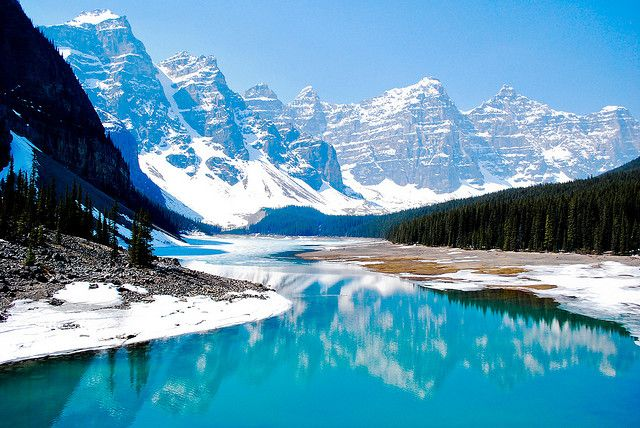 Moraine Lake is a glacially-fed lake in Banff National Park, 14 km outside the Village of Lake Louise, Alberta, Canada. Love how there is still snow on the ground and on the mountains in June!