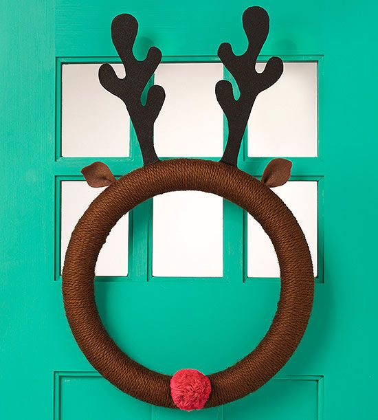This yarn-wrapped Rudolph #wreath is a warm way to welcome holiday visitors to your home.