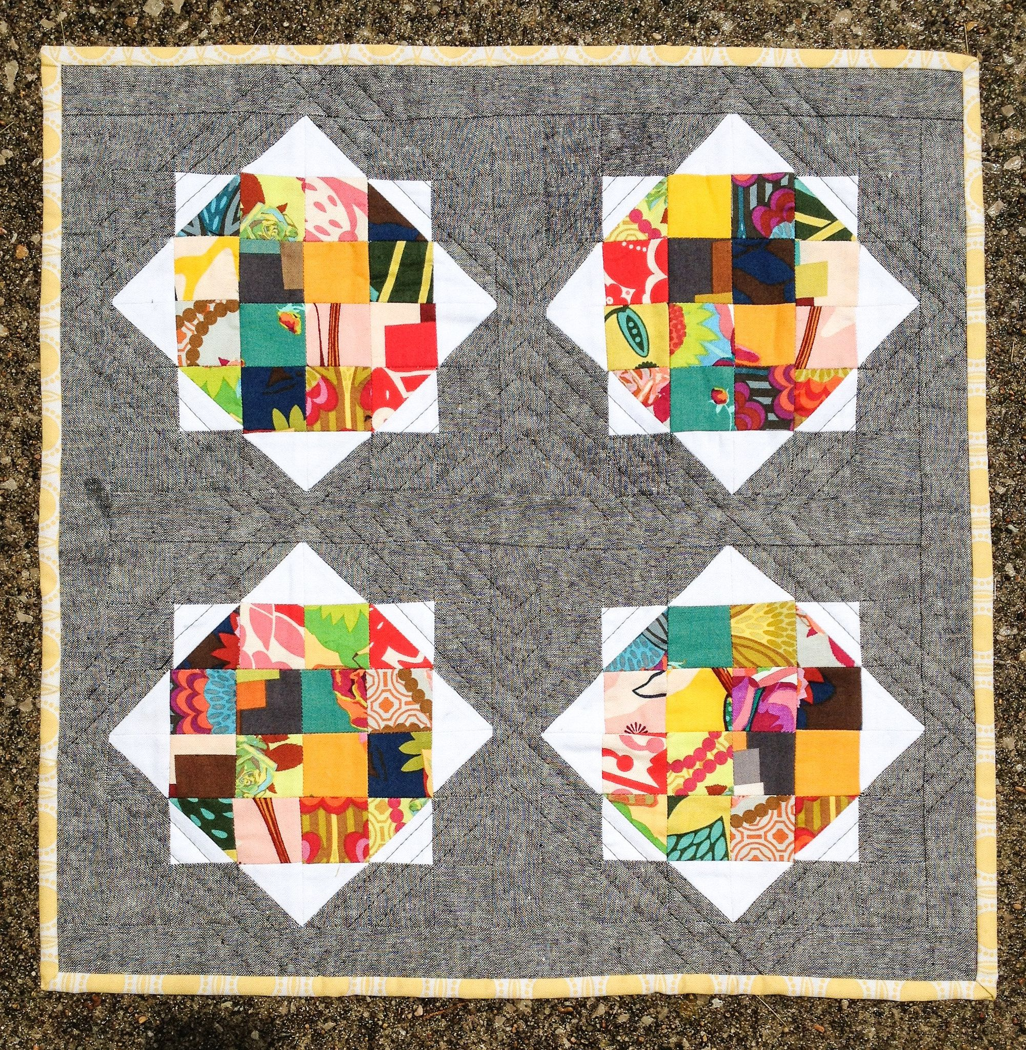 """https://flic.kr/p/ntDHzB   Mini Quilt Swap   Make a quilt, make a friend mini for my partner. A little bit of my partner's faves wrapped into one. AMH Hand Drawn with Essex dyed linen. """"Rise and Shine"""" pattern by Camille Roskelly. Binding is Joel Dewberry."""