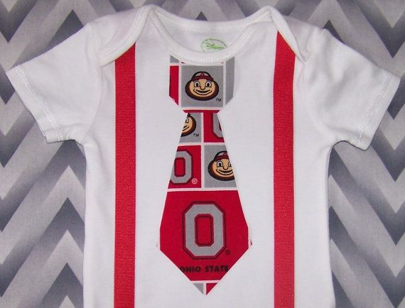 This adorable outfit is perfect for your little Ohio State fan. It is available in the following sizes:    0-3 Months... up to 11 lbs. 3 Months...