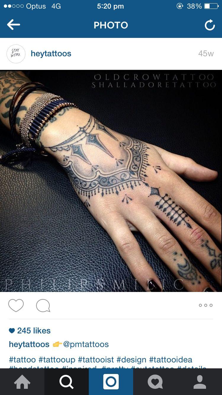 Ornamental hand wrist tattoo