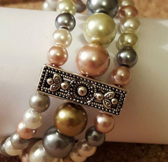Check out this item in my Etsy shop https://www.etsy.com/listing/499965115/pearl-beaded-bracelet-silver-filigree