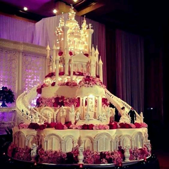 multi tiered royal castle wedding cake with stairs lights and windows