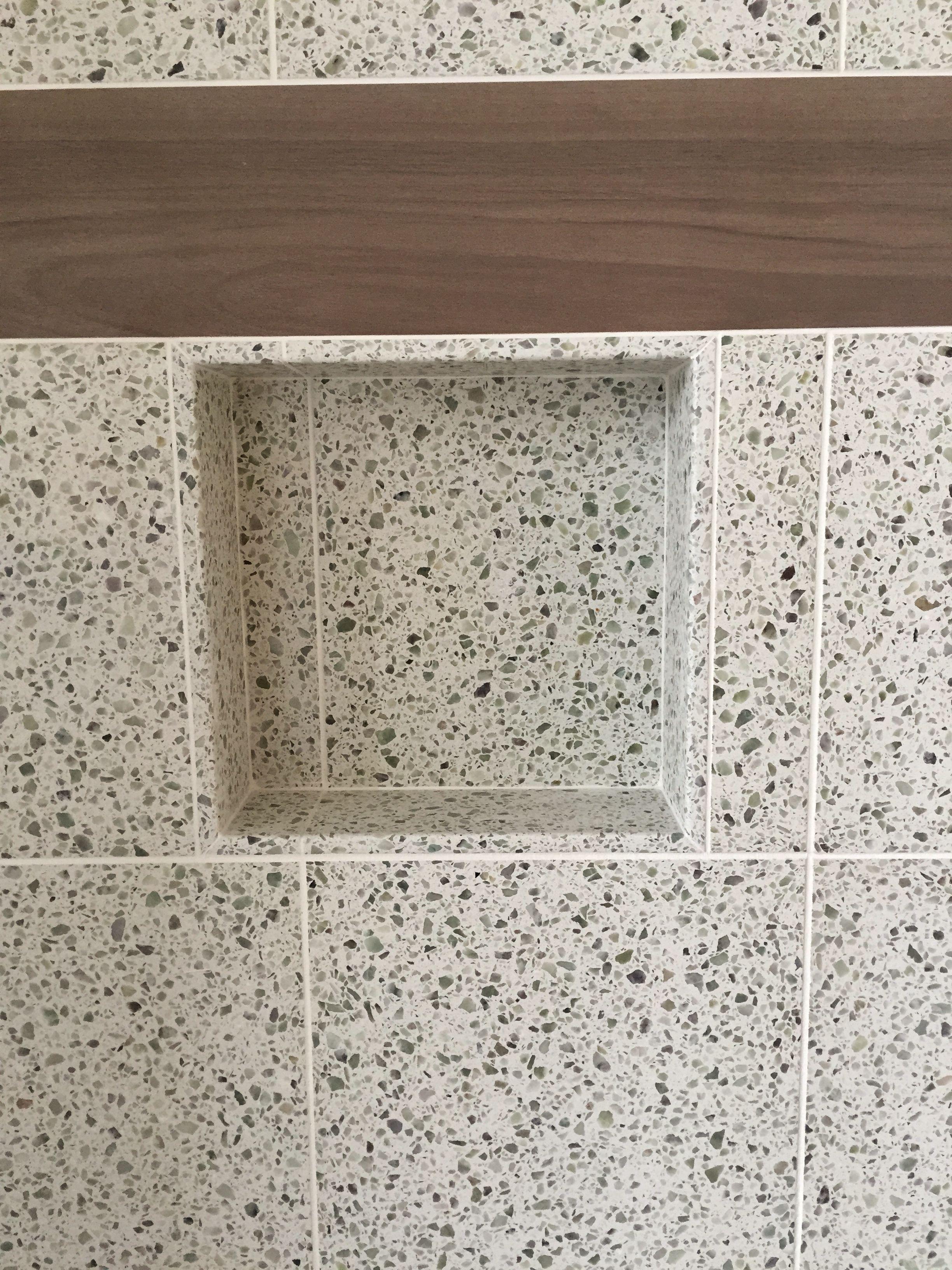 Master shower 12x24 porcelain tile on walls pebbles on floor niche detail at guest shower 12x12 terrazzo tile with porcelain plank accent doublecrazyfo Images