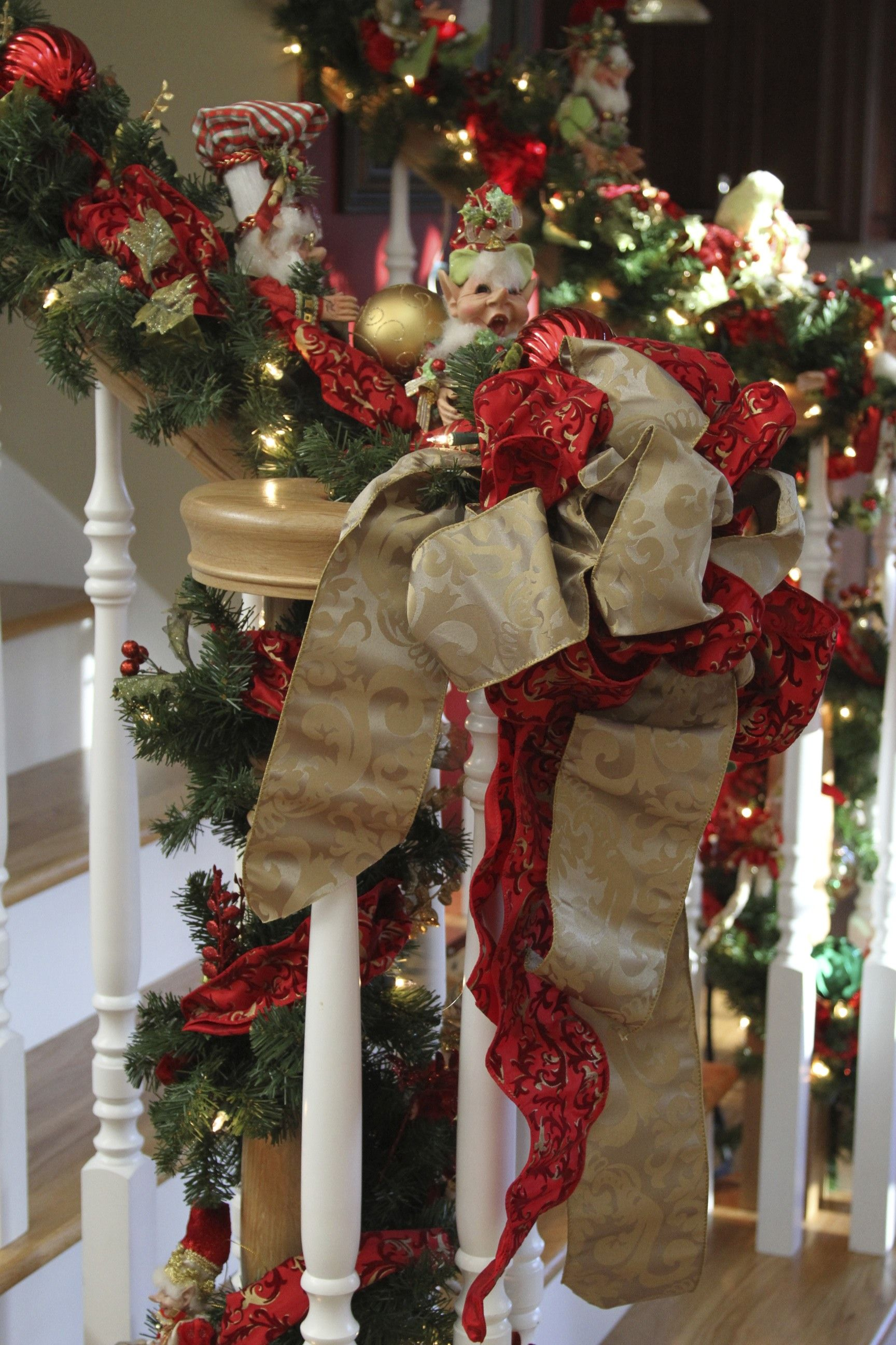 Decorated Christmas Stairs With Ribbon Garland And Mark Roberts Christmas Elves Christmas