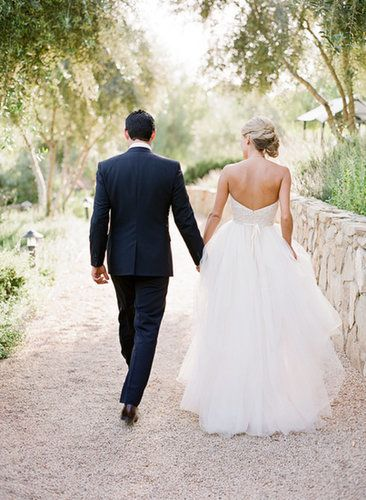 A shot of you and your groom walking away has a nostalgic feel, as if you're officially stepping into your new life, but it's also perfect for showing off the back of a dress. Photo by Lavender & Twine via Style Me Pretty