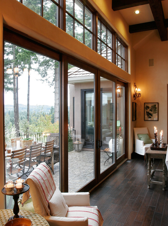 The Great Room In This Home Features Floor To Ceiling Windows In