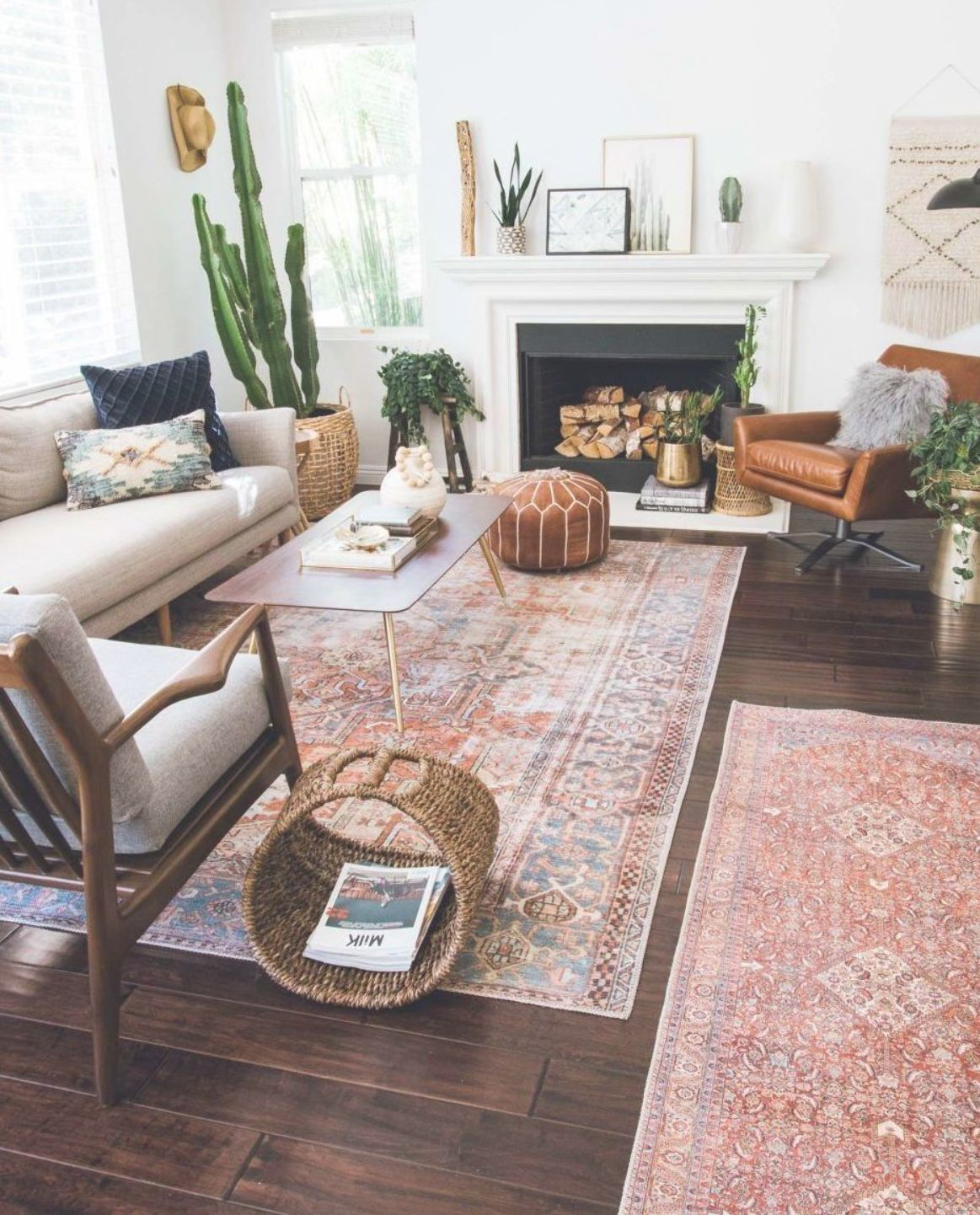 layered and cozy eclectic living space boho vintage and