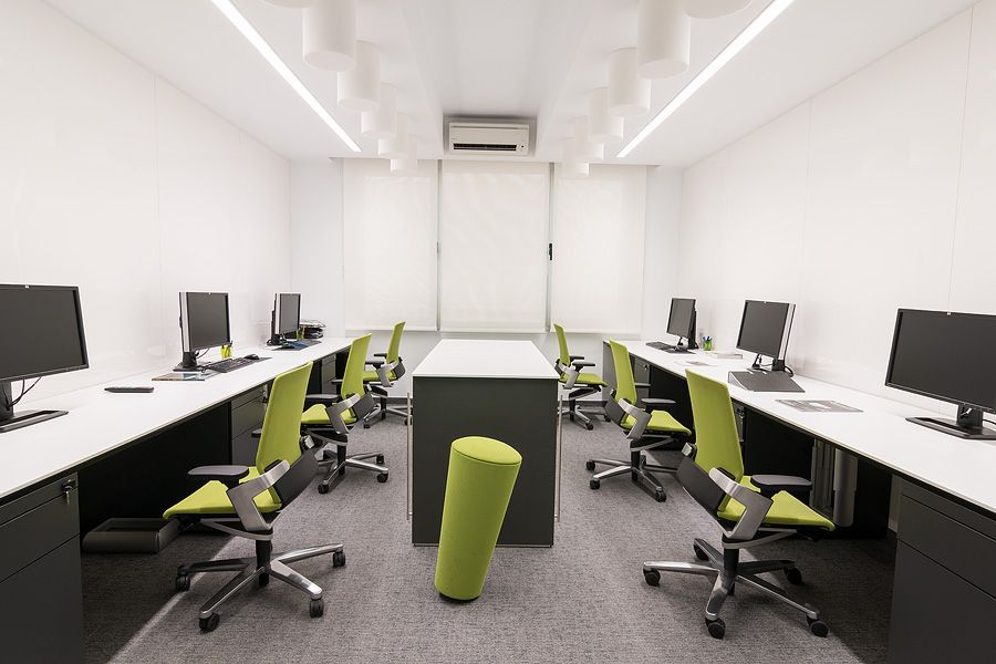 Architectural Firm In Madrid Spain Furnished With On Office Chair And Stand Up