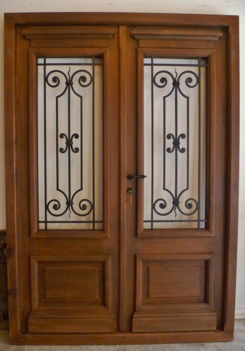 Puertas de madera buscar con google herreria for Puertas de madera con herreria