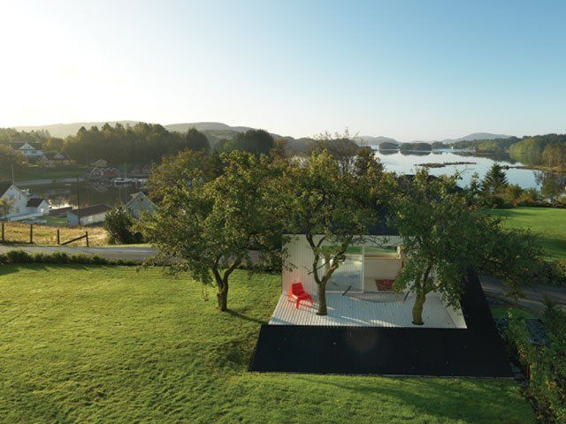 Photography by Bent René Synnevåg: In what seems a counterintuitive move, Saunders used part of the minimal square footage to create a terrace, framed by extended arms of the cabin, across which march two of the sculptural plums. http://iadmagazine.com/article.php?id=10226 #architecture #design