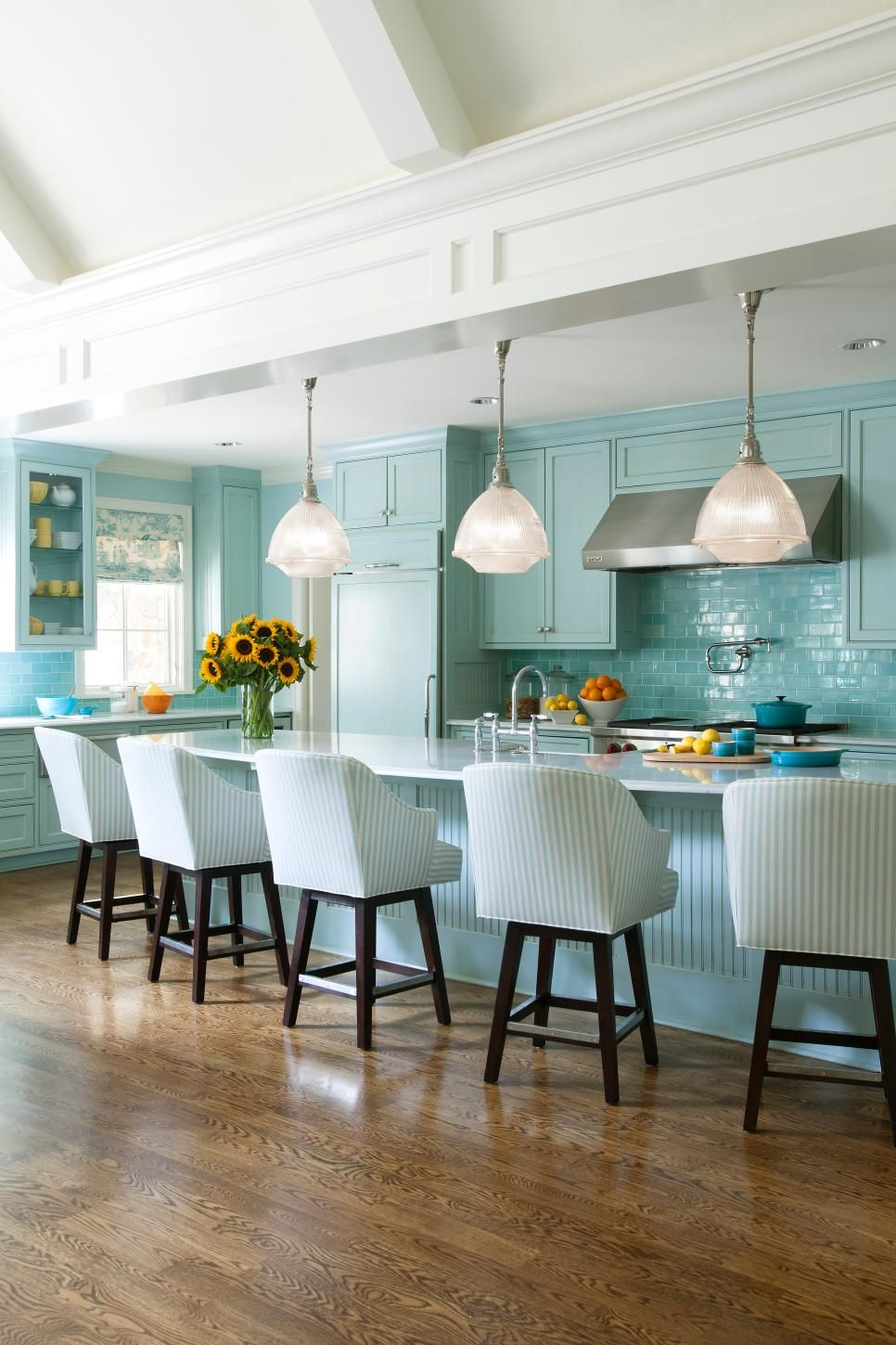 Mornings must be fun in this cheery blue transitional kitchen a
