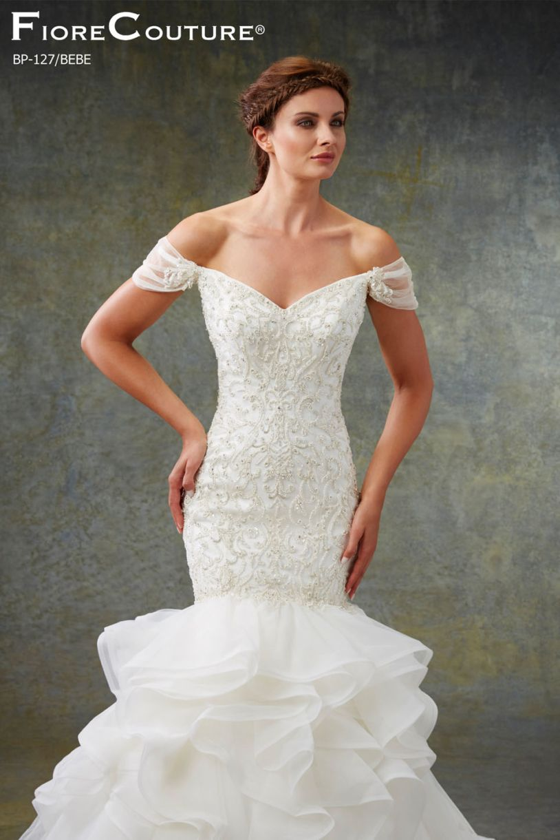 Off shoulder neckline fit and flare silhouette wedding dress style