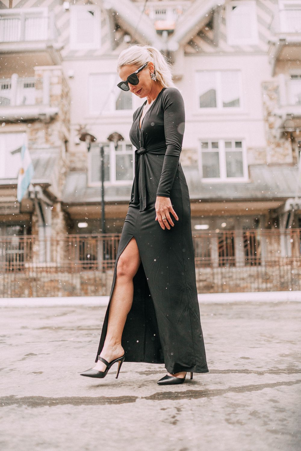f558a1631713 Unexpected holiday party outfits featuring a long black maxi dress with high  slit to show off