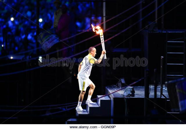 Vanderlei Cordeiro de Lima carries the torch to the cauldron during Rio Olympics opening ceremony, 5th August, 2016. (Stock Photo)  Contributor: Fotoarena / Alamy www.alamy.com http://www.alamy.com/stock-photo-rio-de-janeiro-5th-aug-2016-opening-of-the-rio-2016-olympics-vanderlei-113557970.html