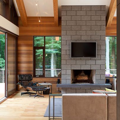 Living room concrete block fireplace natural wood - Glass block windows in living room ...