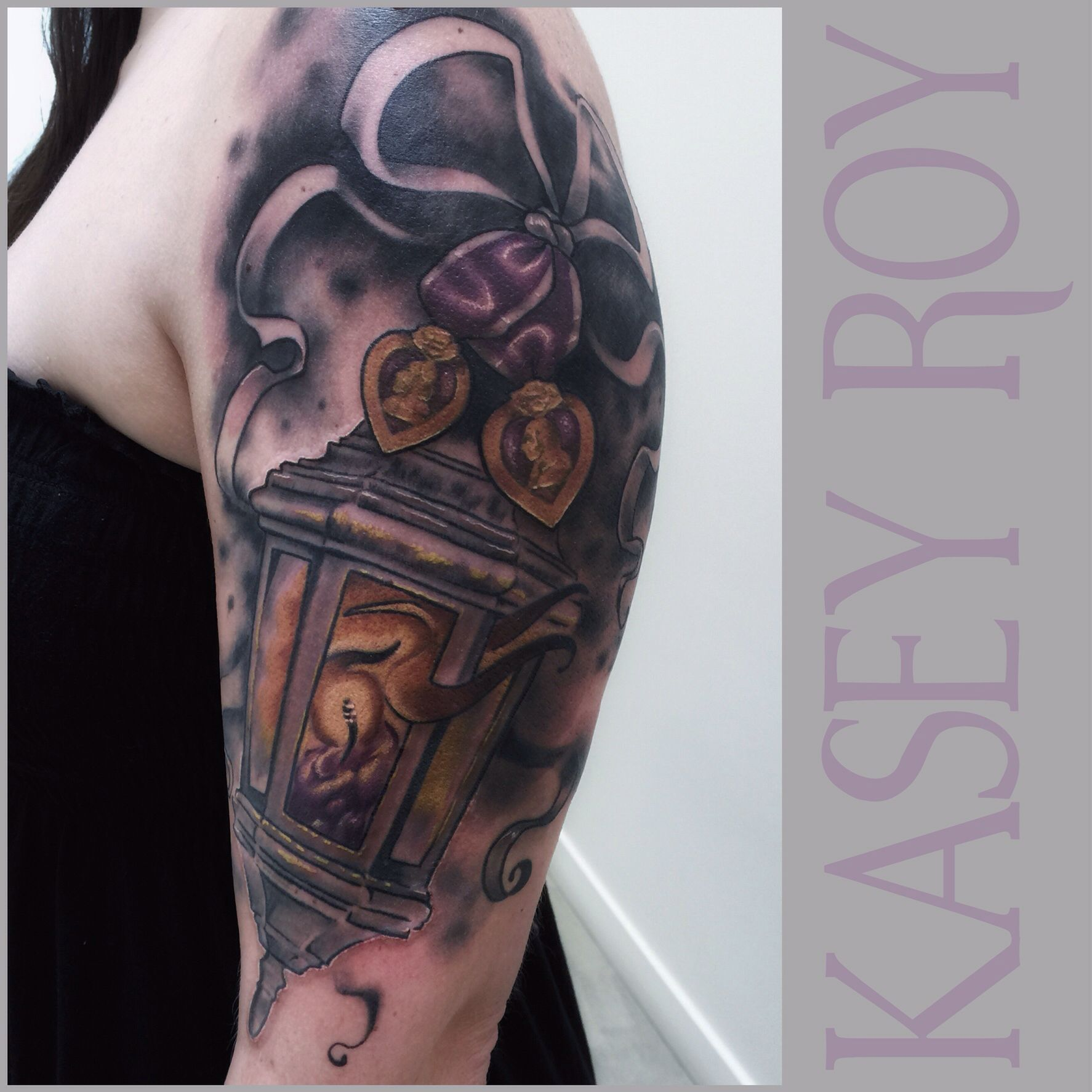 Purple Heart and candle lantern tattoo. Kasey Roy Tattoos