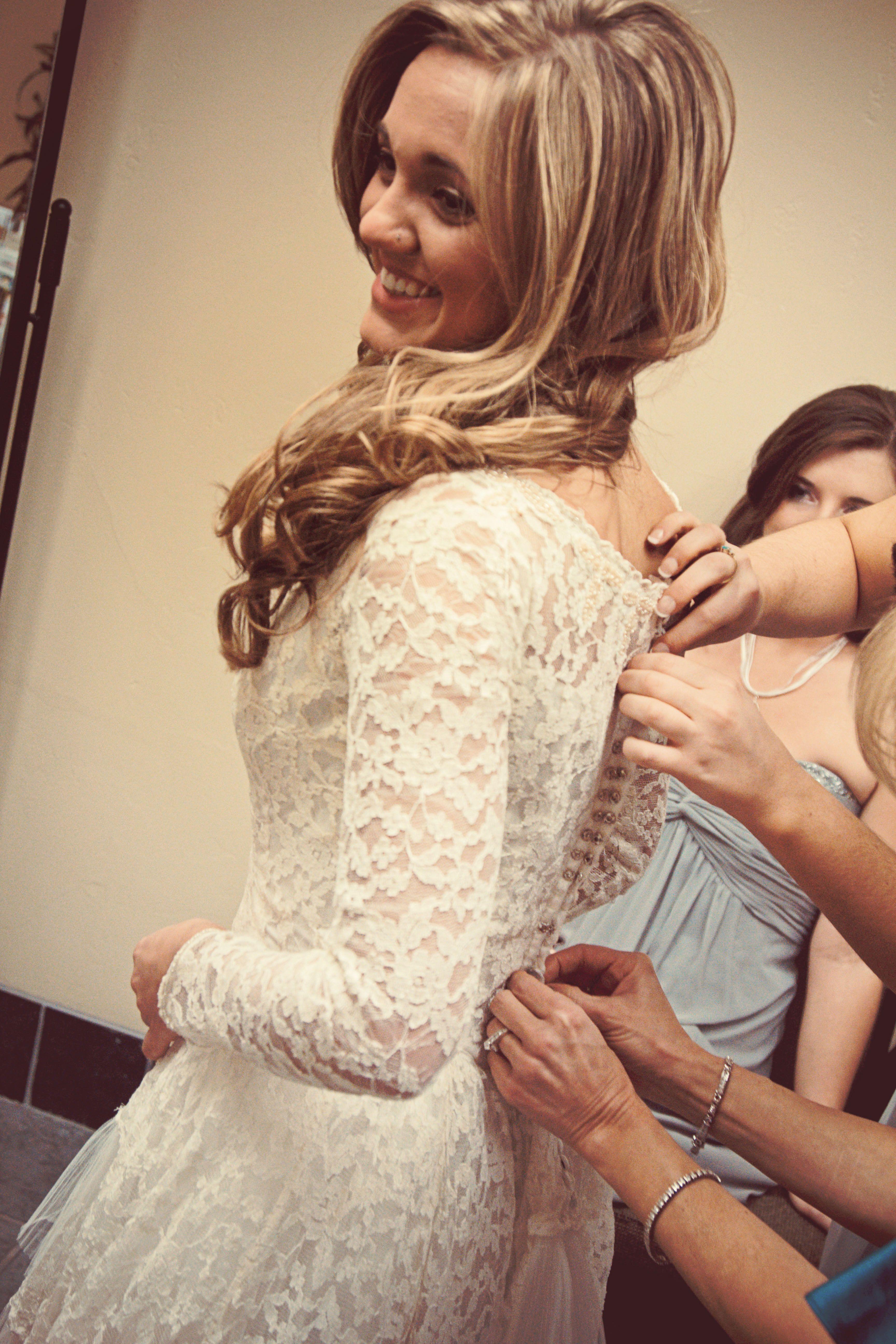 Vintage lace wedding dress. Bride getting ready. Lace