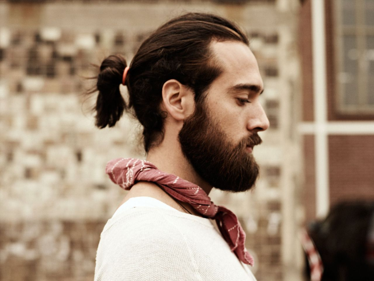 one either loves or hates ponytails on men. i happen to love them
