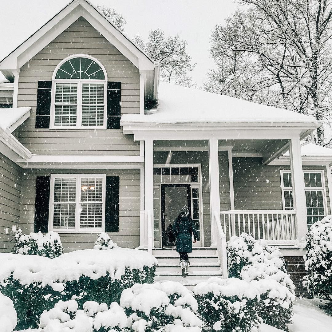 Snowy Tan Exterior Of Home Black Shutters Winter House Exterior House Paint Exterior Shutters Exterior