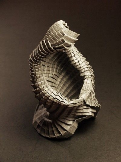 Mathmematician/ artist Goran Konjevod's folded paper sculpture...find more on Daily Art Muse....