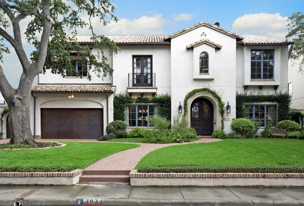 Spanish influenced home with a white stucco finish for Spanish style exterior