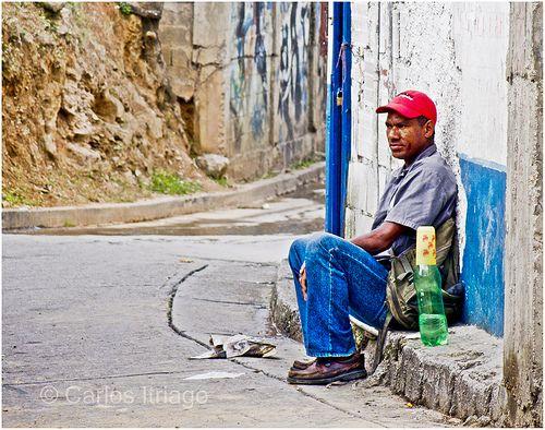 "Esperando....¿qué? Shantytown in Venezuela. The French word is: ""Bidonville."""