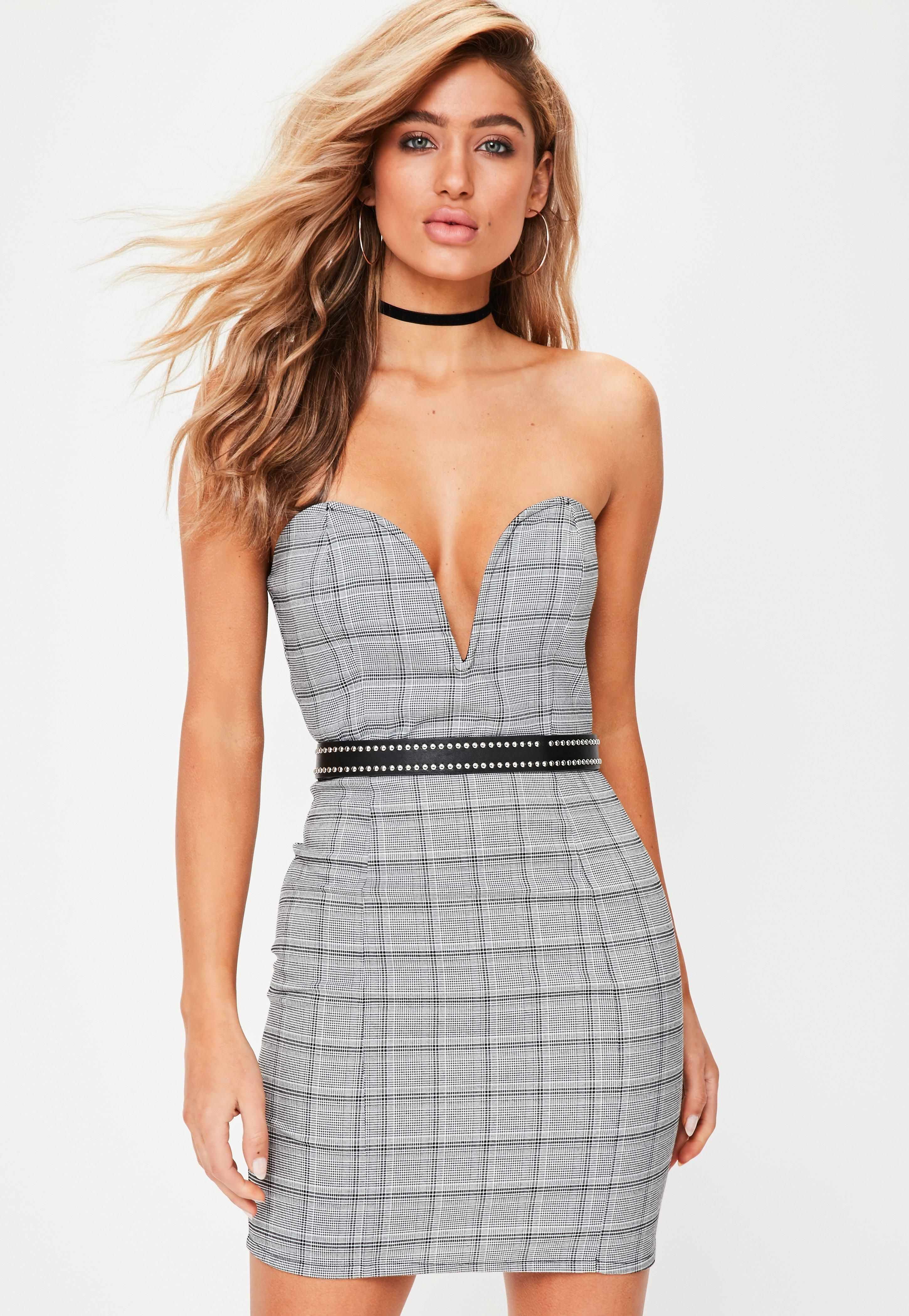 Take the plunge wearing this black and white checked dress. Featuring a mini length, plunge front and bandeau style.
