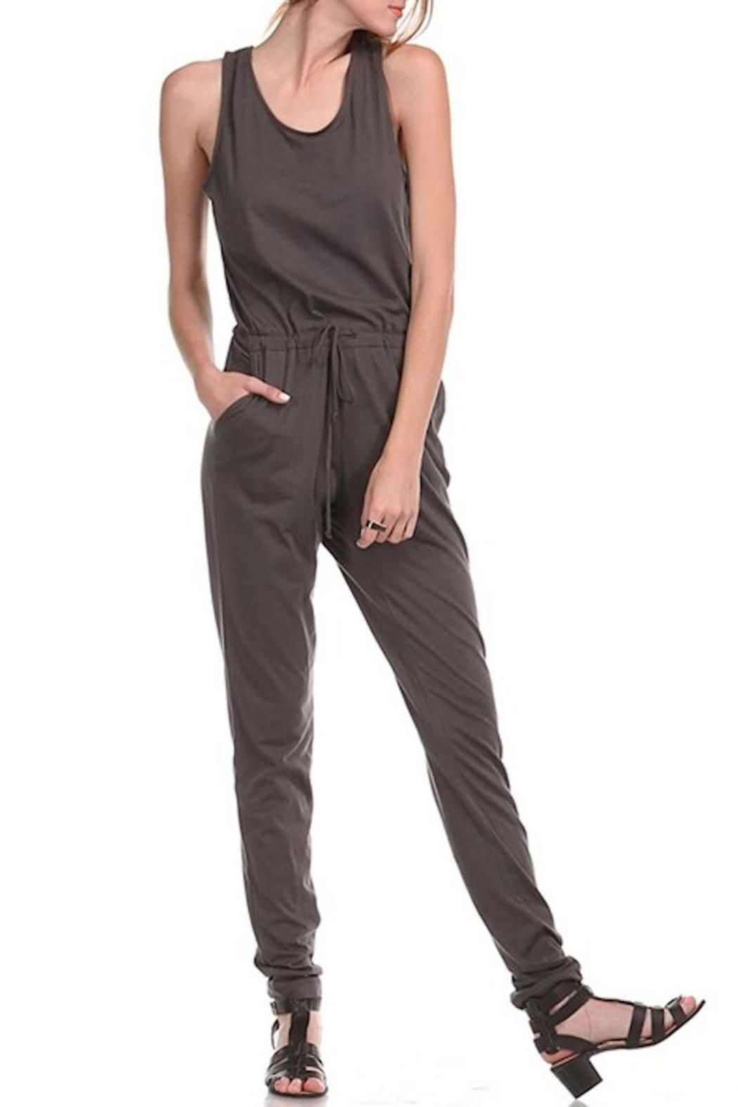 "Charcoal jumpsuit with drawstring waist and pockets. The open back has strings that tie the top together at the shoulders.    Measures: 34"" inseam    Drawstring Waist Jumpsuit by Brea. Clothing - Jumpsuits & Rompers - Jumpsuits North Dakota"