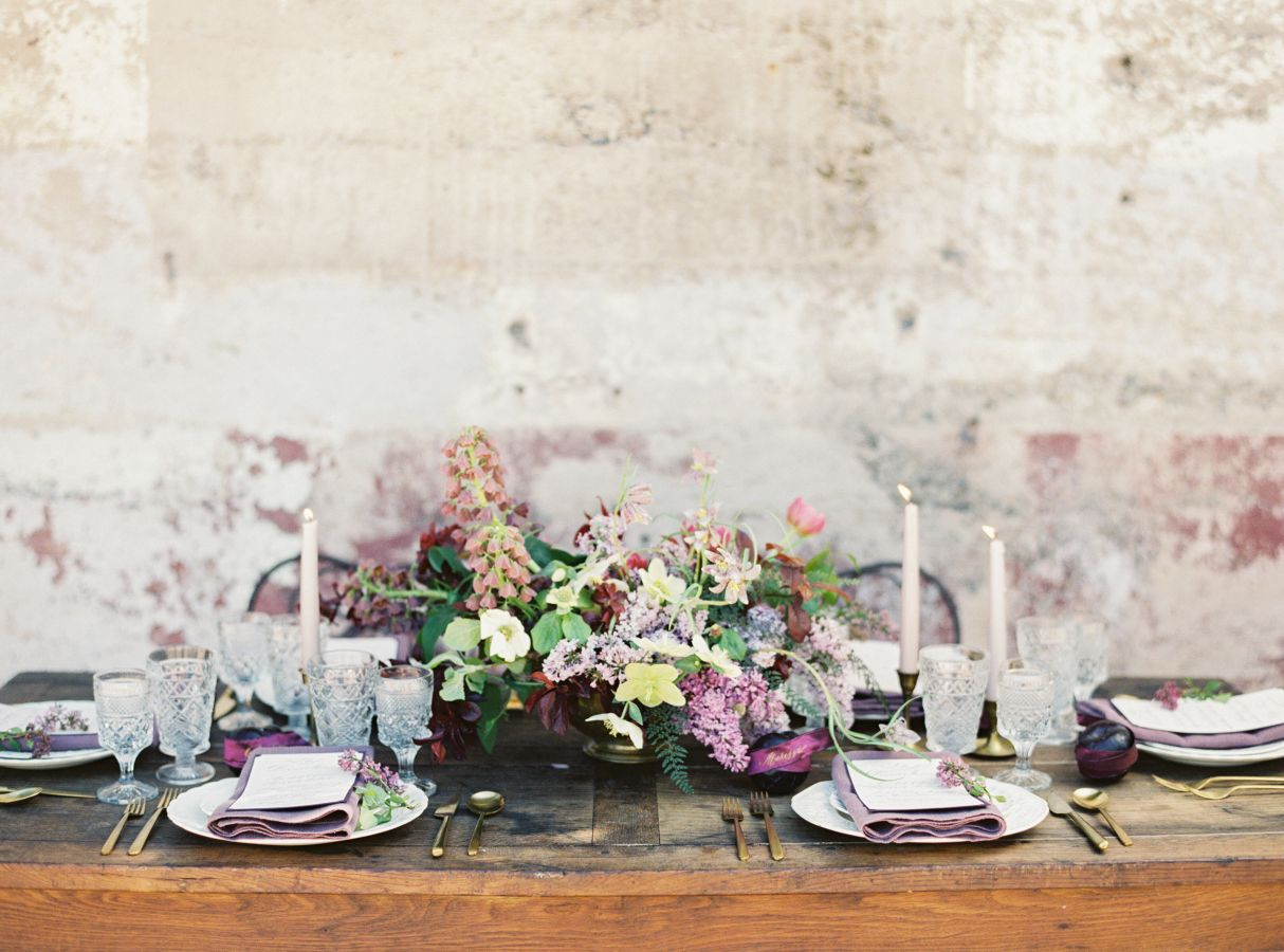 Rich hues of lavender, plum and burgundy married with glamorous La Tavola textiles are the makings of this shoot from the lens of Jessica Burke. She teamed up with a crew of talented vendors, including Cassy Rose Events, Studio Mondine, One True Love Vintage Rentals, Curlicue Designs plus