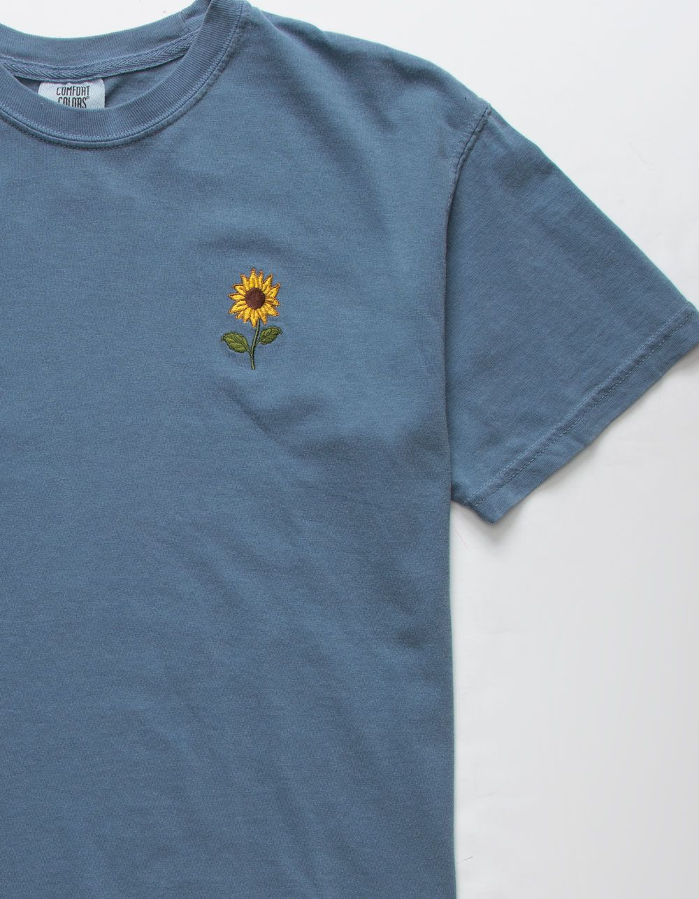 Riot Society Sunflower Embroidered tee. Embroidered sunflower at the left chest. Short sleeve. Crew neck. 100% cotton. Machine wash. Imported.