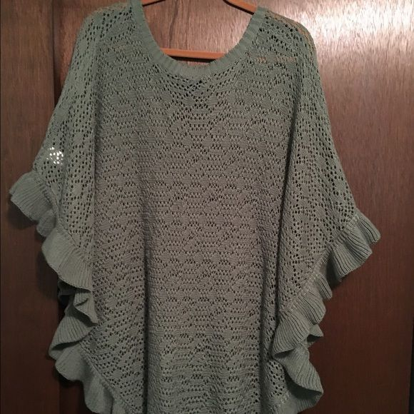 Matching tank and poncho in seafoam green. The poncho is a semi-sheer, lightweight knit edged with a ruffle and is made to be worn over the matching tank. They look great together.. Roamans Sweaters Shrugs & Ponchos