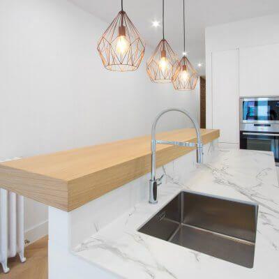 Reforma de vivienda en el barrio de Salamanca (Madrid) Cocina - bao de piedra