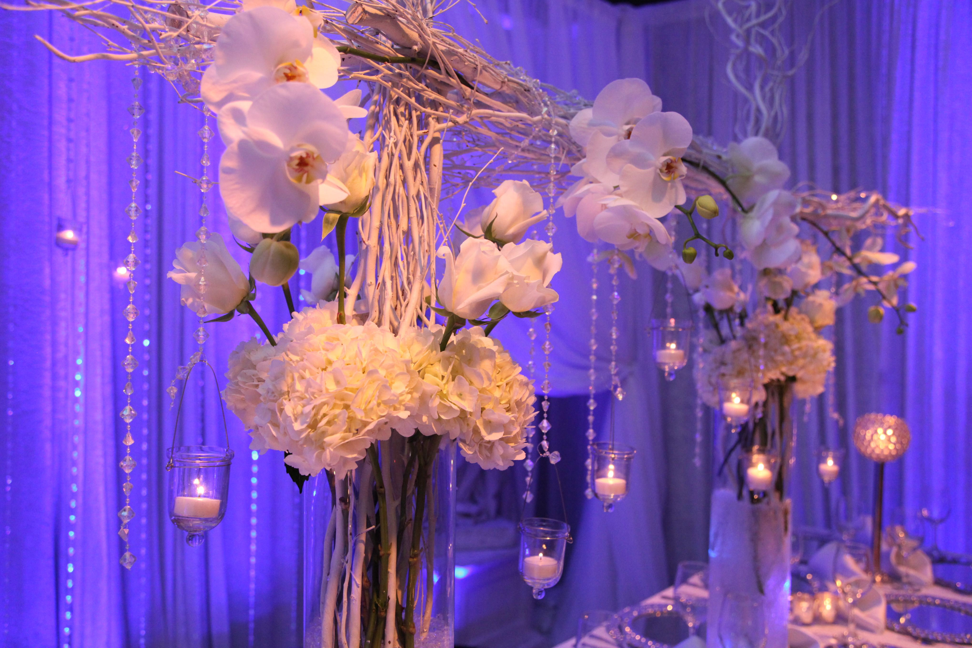 Clean And Elegant Arch Center Piece Using Tree Branches And Hanging