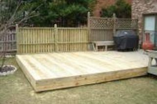 How To Make A Ground Level Wooden Deck Hunker Building A Floating Deck Floating Deck Decks Backyard
