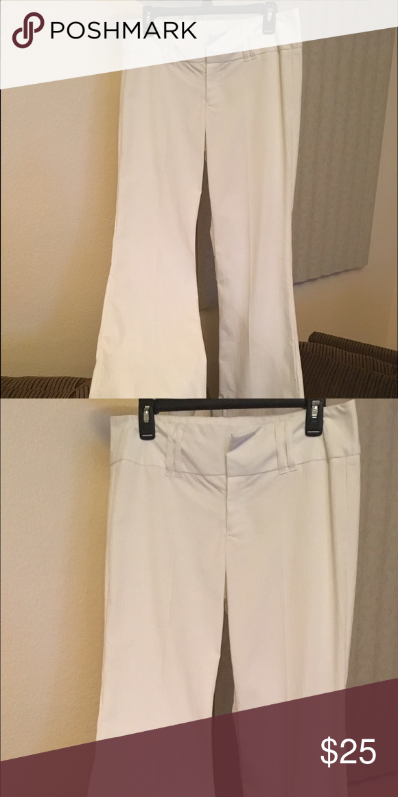 White dress pants New without tags white dress pants. Never been worn. Bought them for work, but never worn. Perfect condition. Pants Boot Cut & Flare